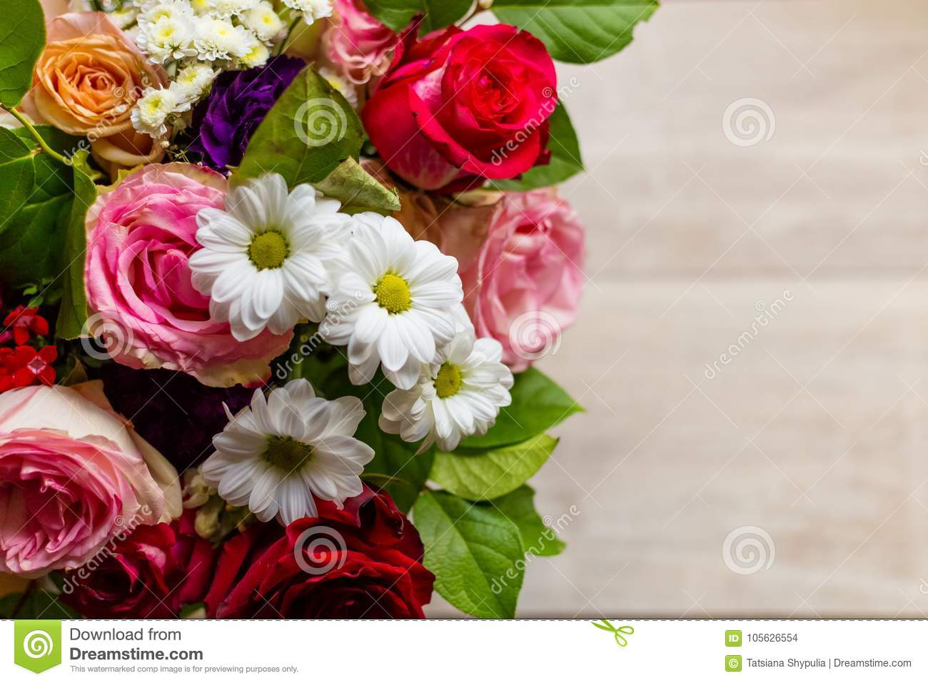 Beautiful colorful bouquet of flowers from roses chamomiles and beautiful colorful bouquet of flowers from roses chamomiles and greenery on the table izmirmasajfo