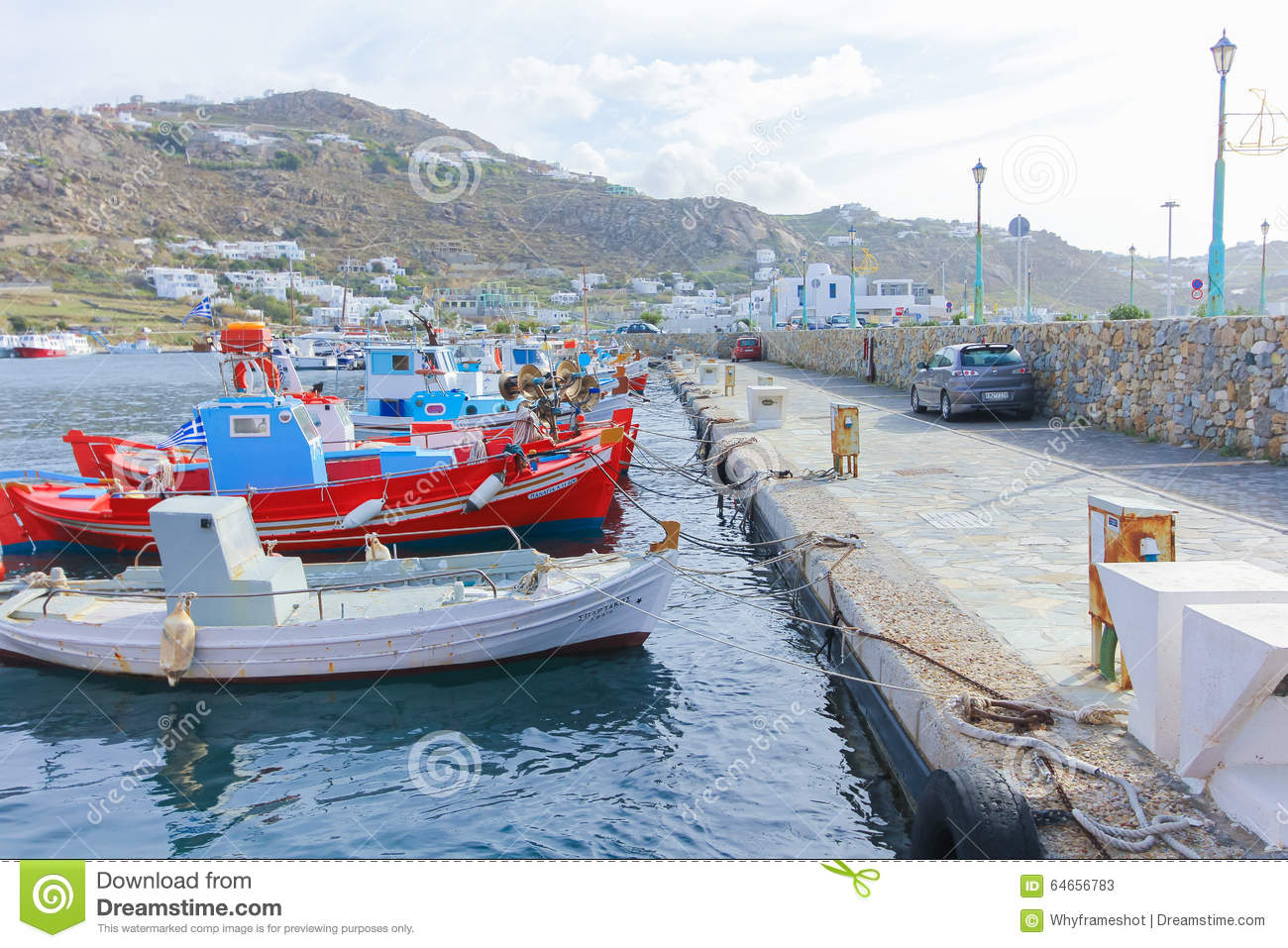 Beautiful colorful wooden fishing boats on row mykonos for Fishing row boats