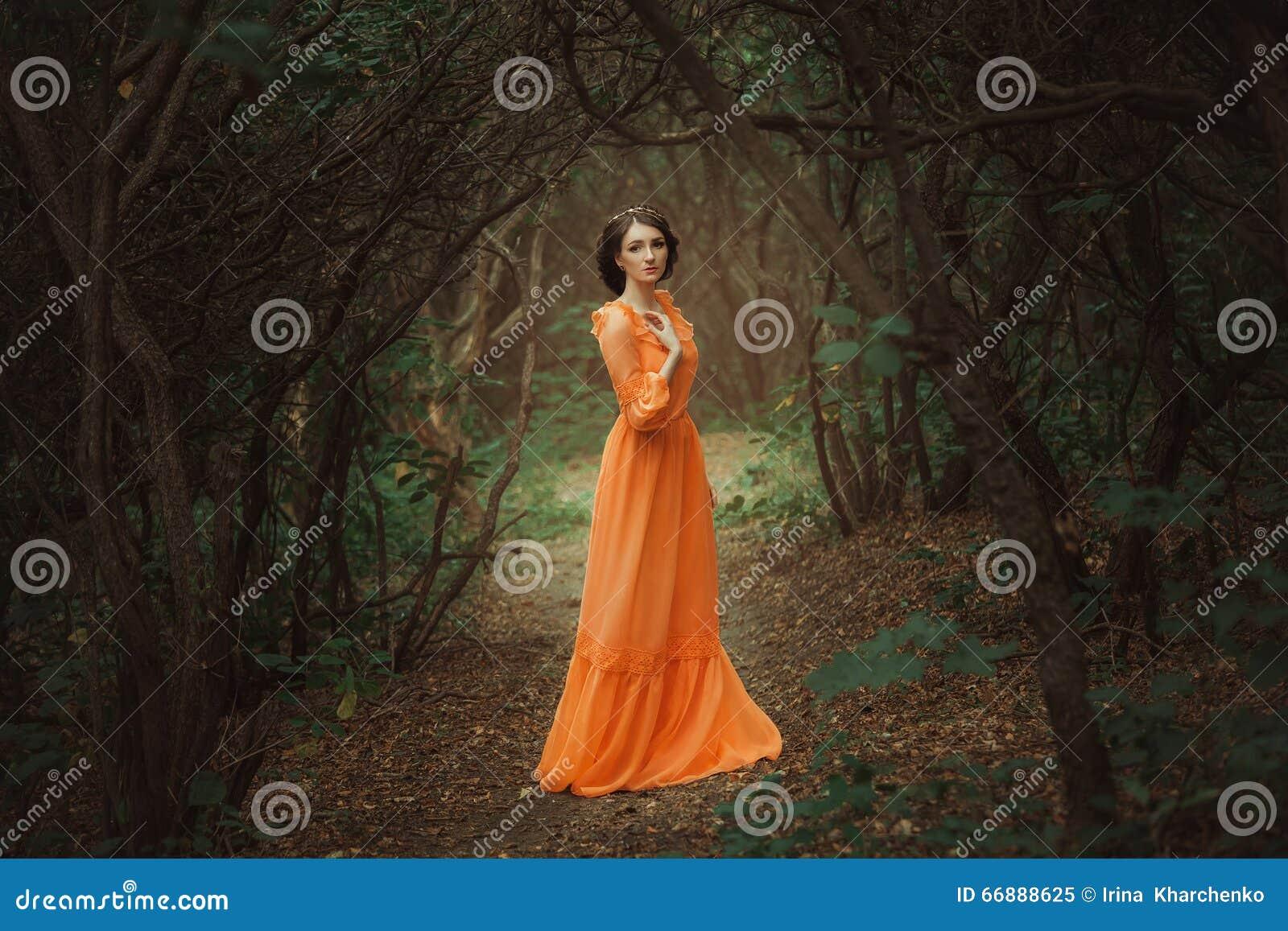 The beautiful countess in a long orange dress