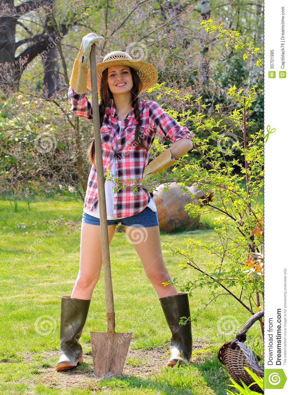 Beautiful Country Girl Poses With A Shovel Royalty Free