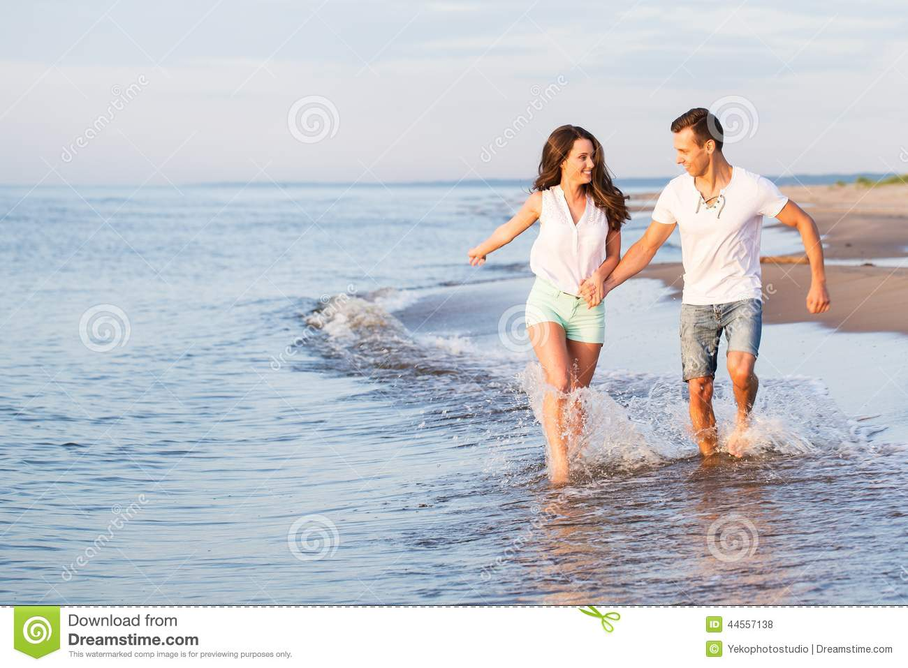 Beautiful Couple On The Beach Stock Photo Image Of Hands Body