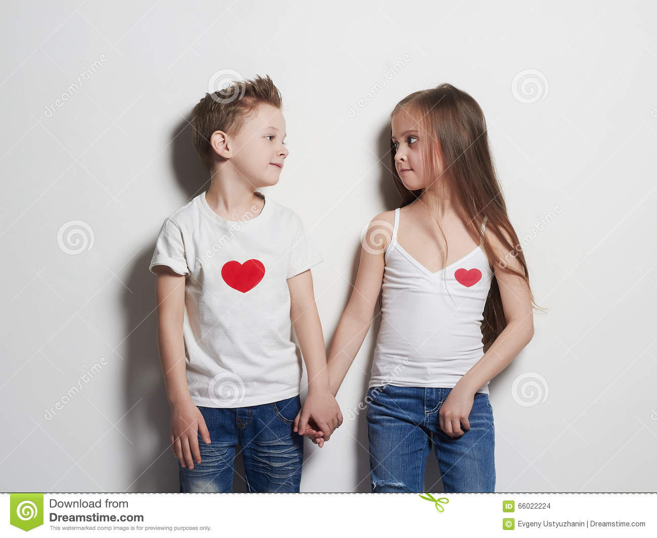 Beautiful Couple Beauty Little Girl And Boy Holding Hands Stock