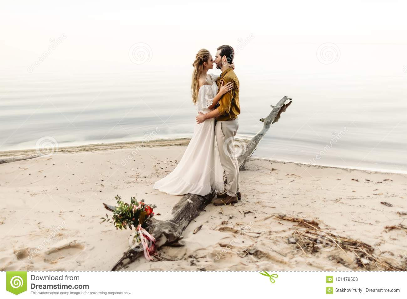 A Beautiful Couple Is Embracing On The Sea Background ...