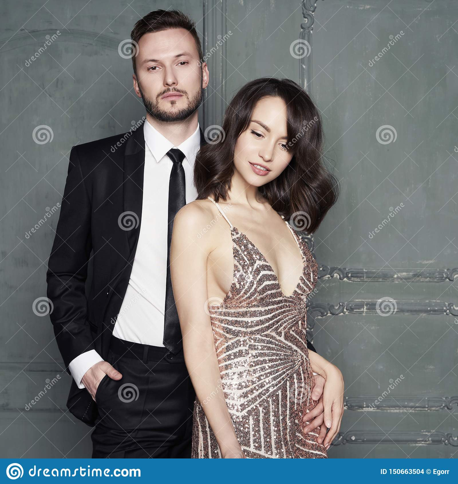Glamour portrait of young lovers. Fashionable elegant man and woman
