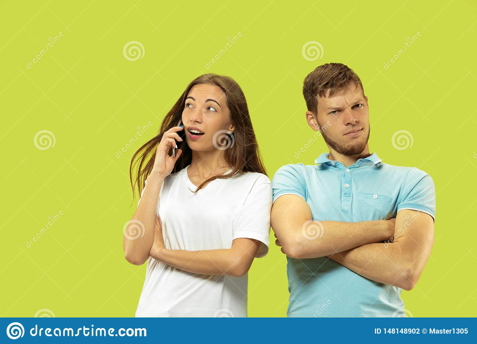 Beautiful couple isolated on green studio background