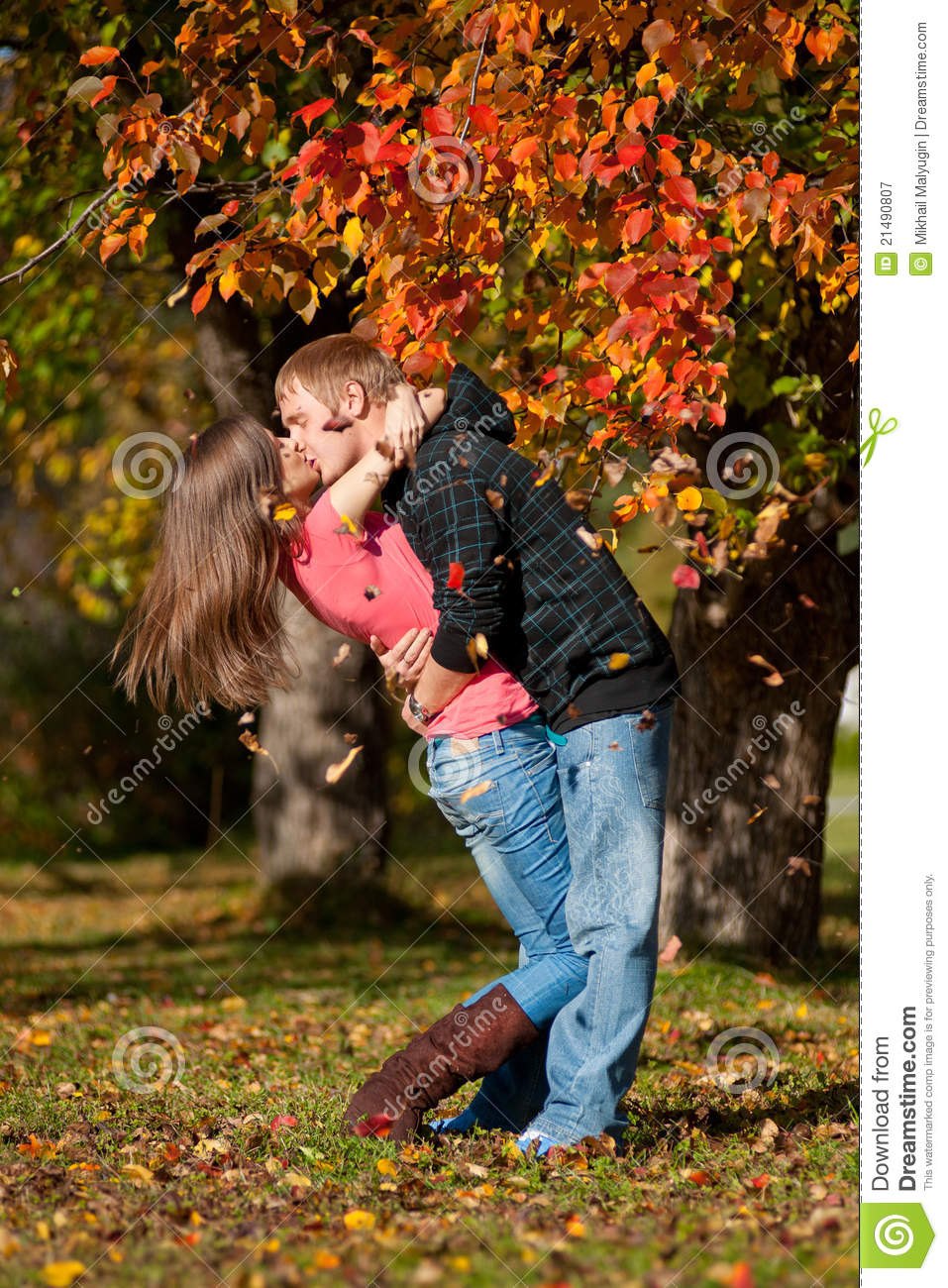 Beautiful Couple Kissing In Autumn Park Royalty Free Stock Photography - Image 21490807-1492