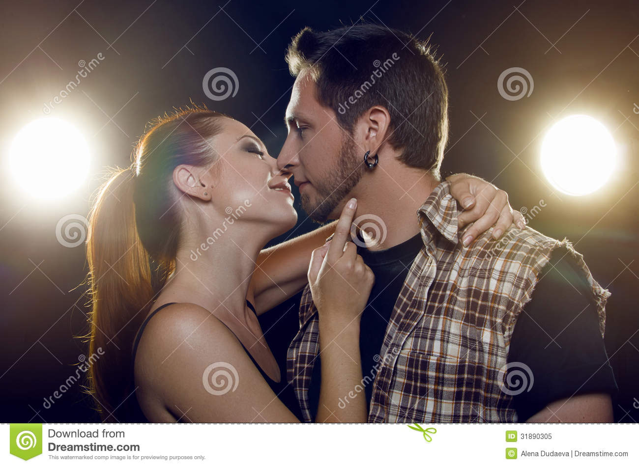Beautiful couple in love flirting. the girl wants to kiss a guy. black