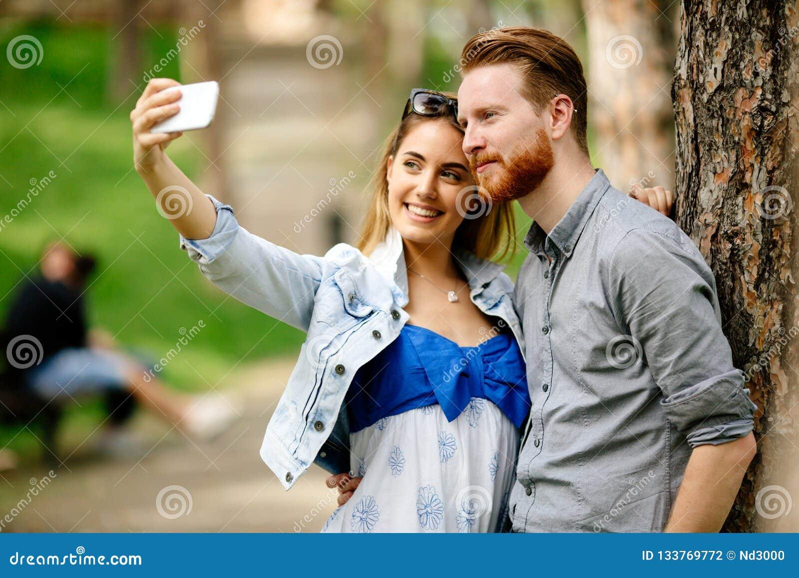 Beautiful couple in love taking slefies