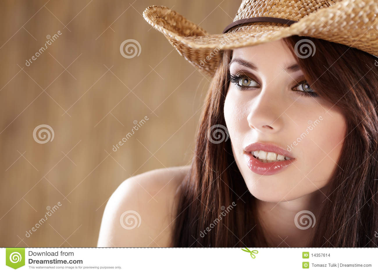 Beautiful cowgirl fashion portrait in american style