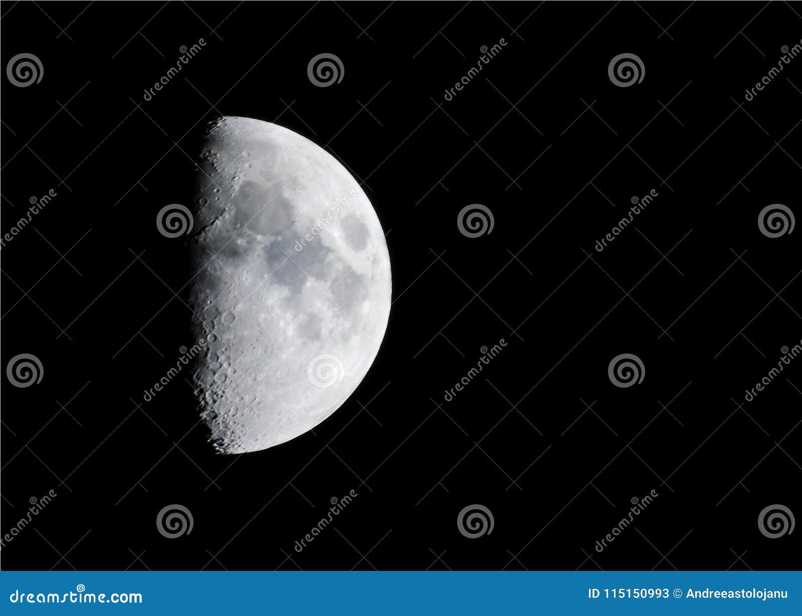 Closeup Of Big Illuminated Gibbous Moon Isolated On Black Sky