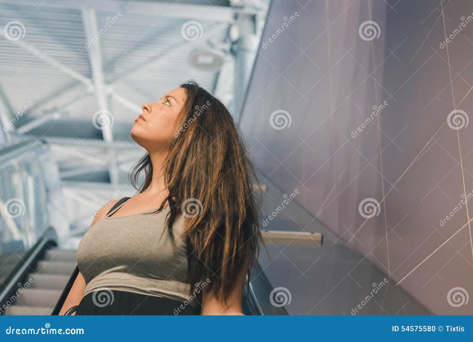 Beautiful Curvy Girl Posing On Escalator Stock Photo - Image