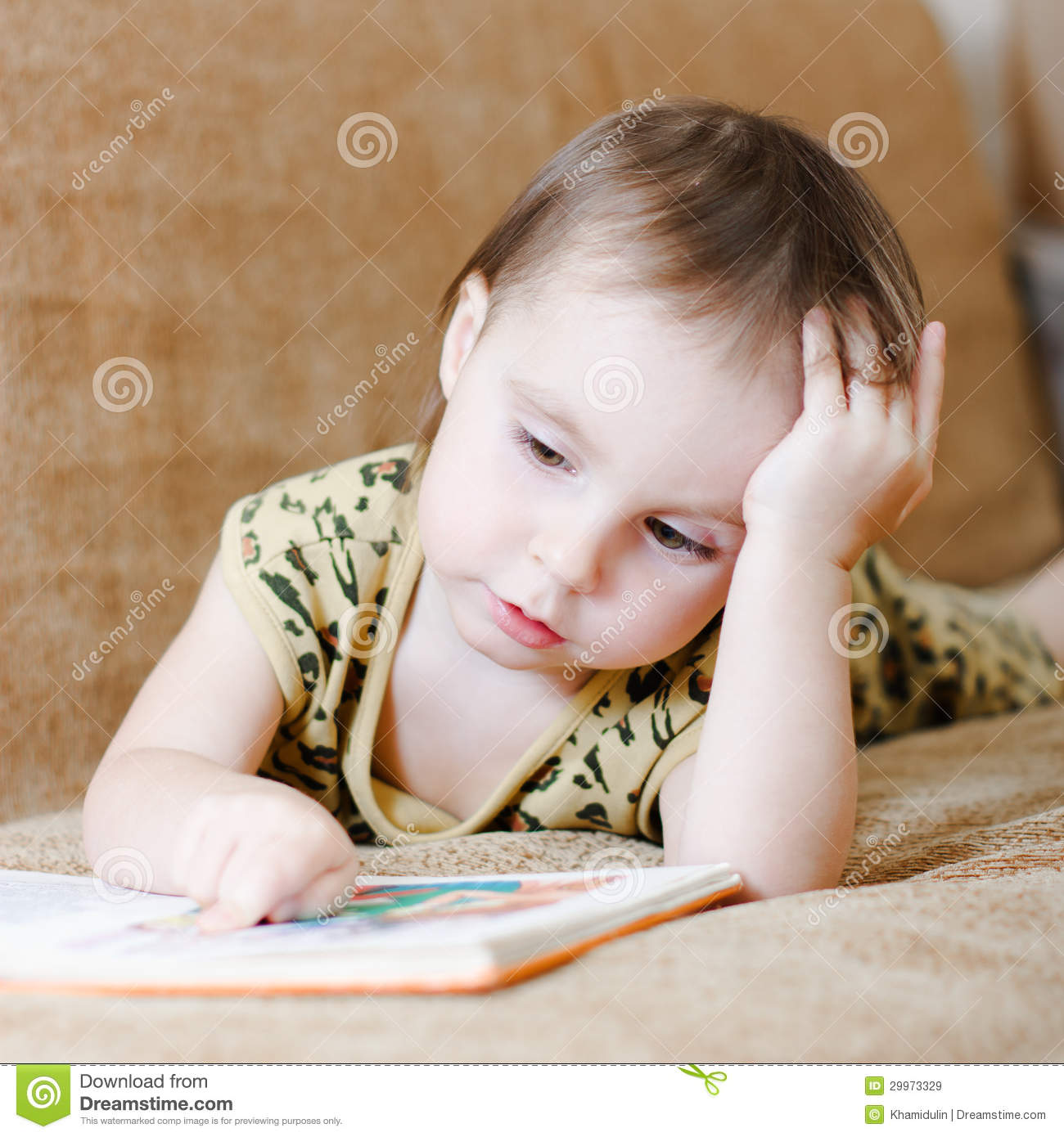 beautiful cute baby reading a book royalty free stock images