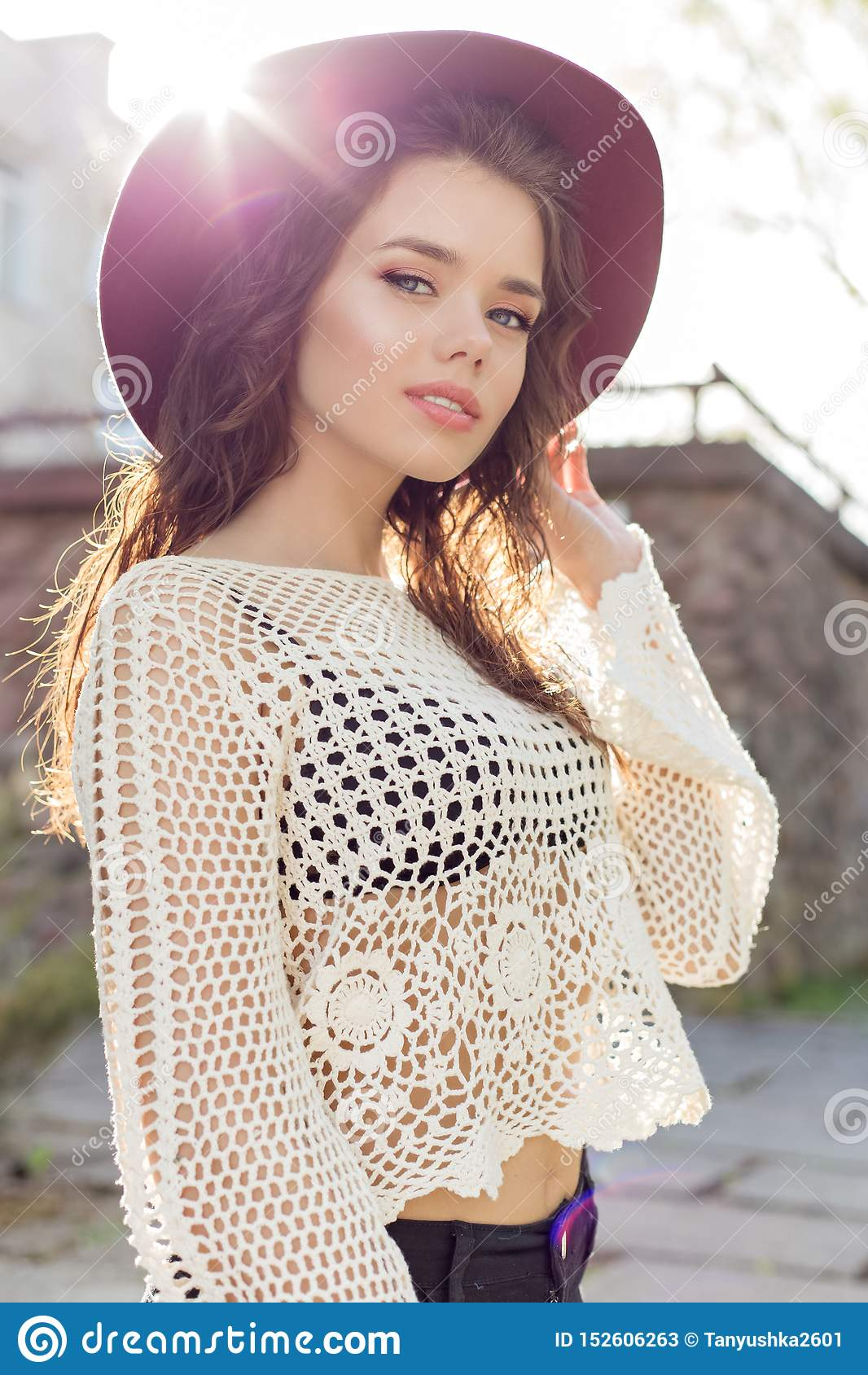 Beautiful Cute Girl With Curly Hair In A Hat Walking At Sunset ...