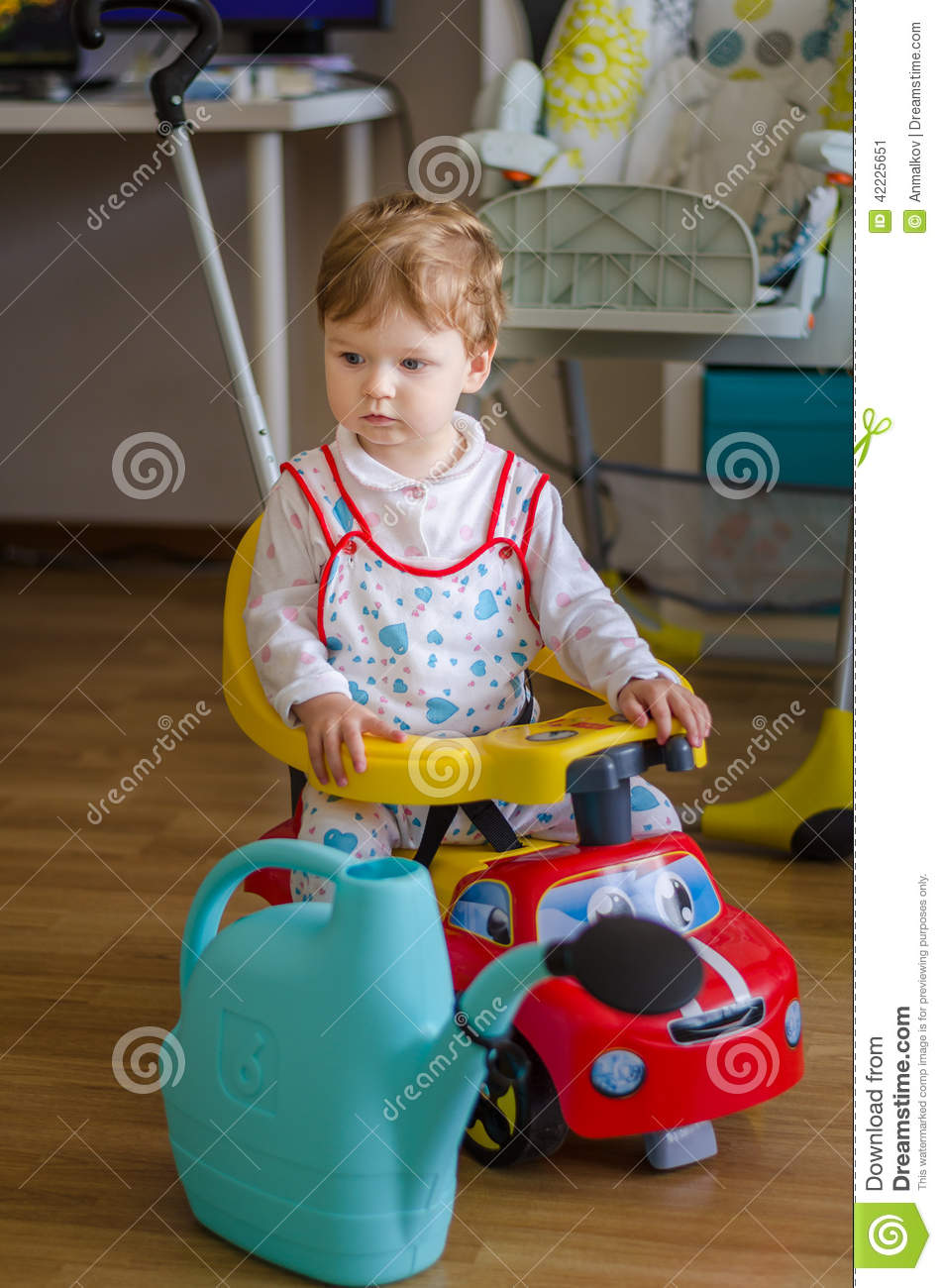 Little Boy Toys : Cute little boy playing car royalty free stock photography