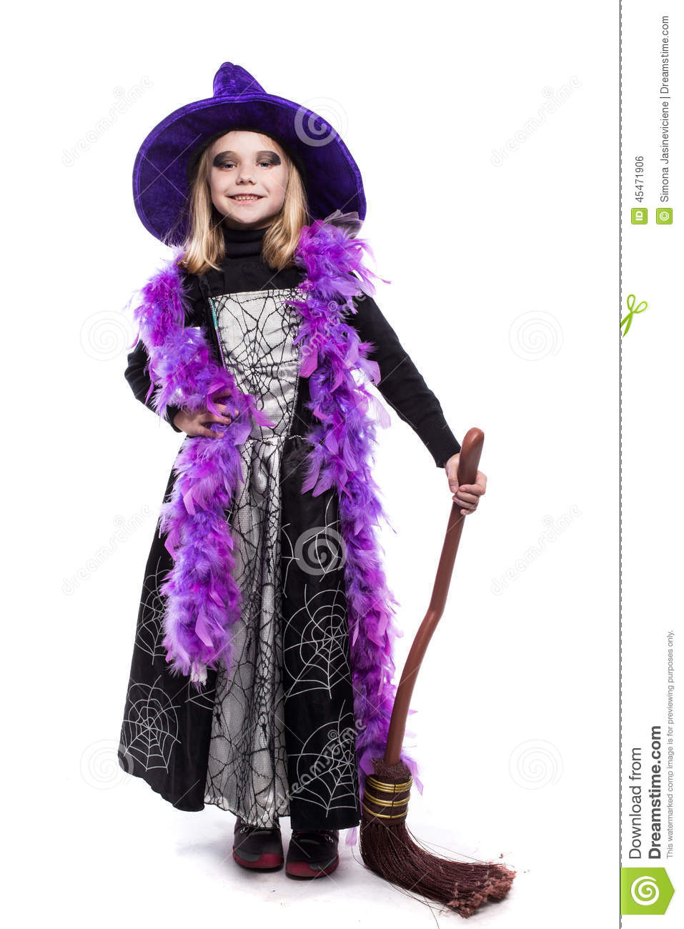 Beautiful Cute Little Girl In Witch Halloween Costume Hold The ...