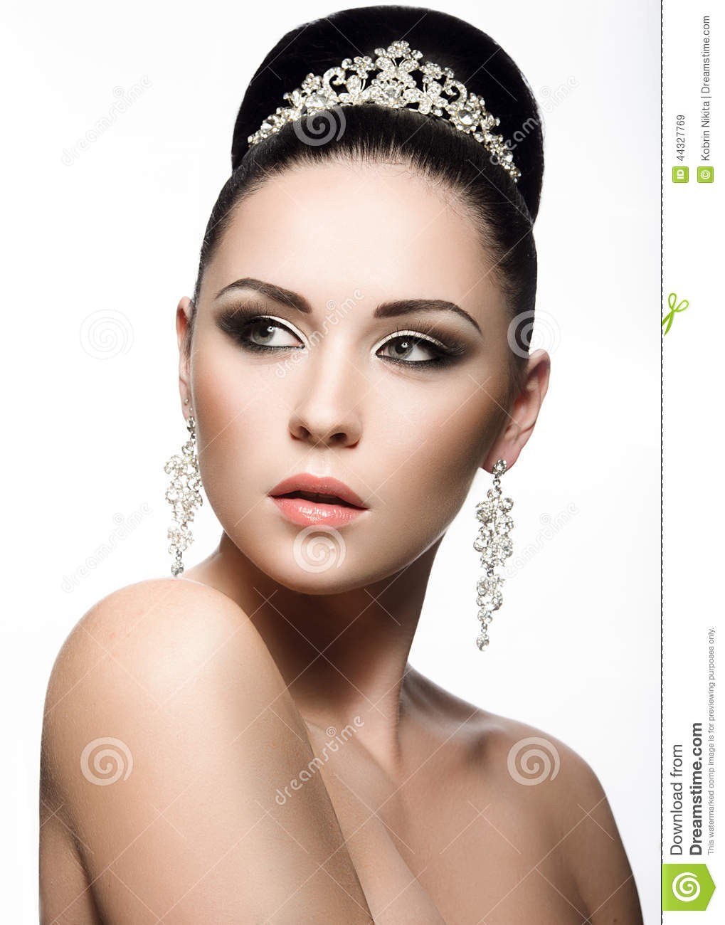 Beautiful dark-haired girl in the image of a bride