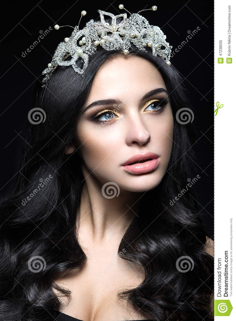 Beautiful Dark-haired Woman With A Crown Of Precious ...