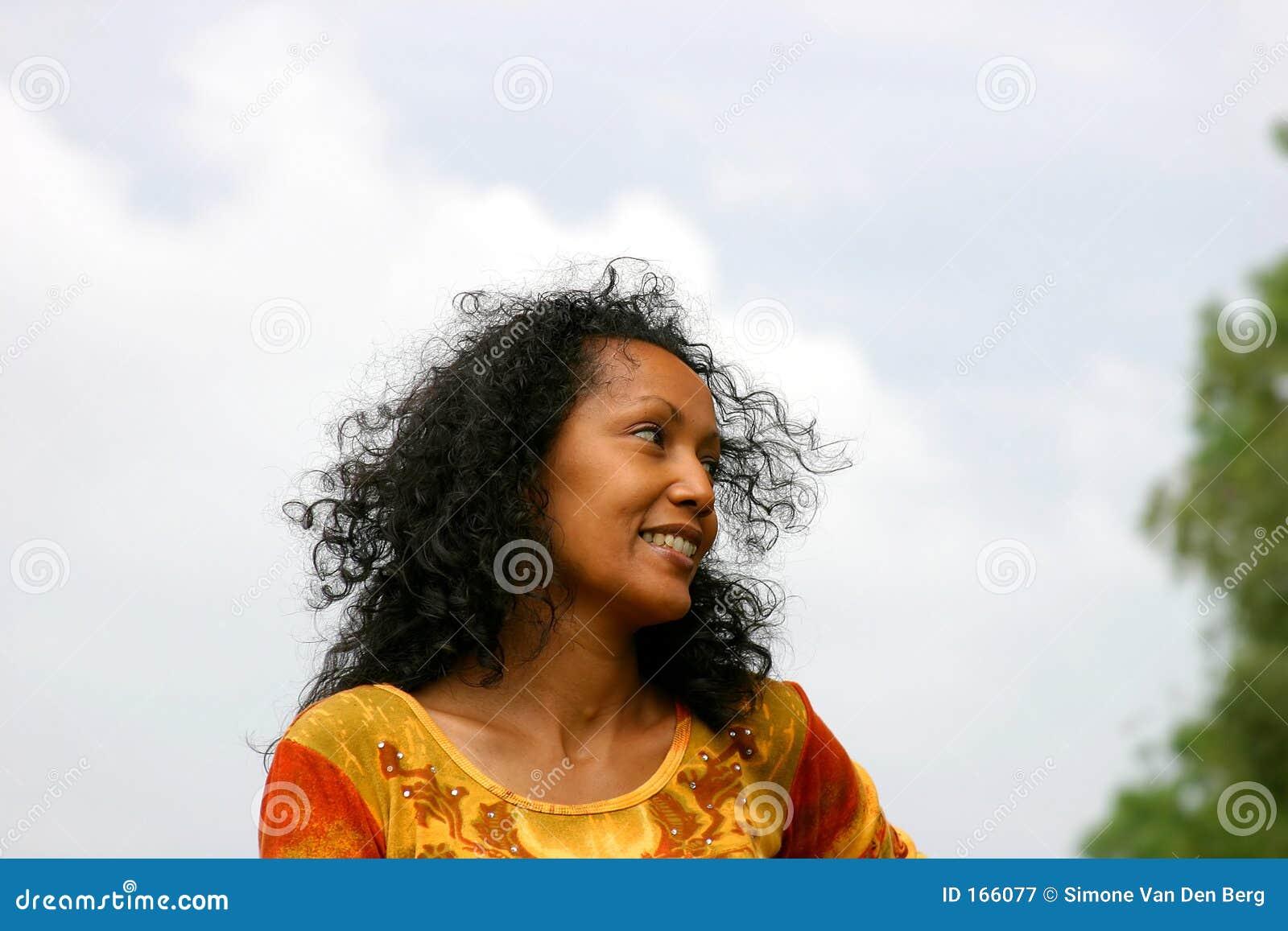 Beautiful dark woman smiling