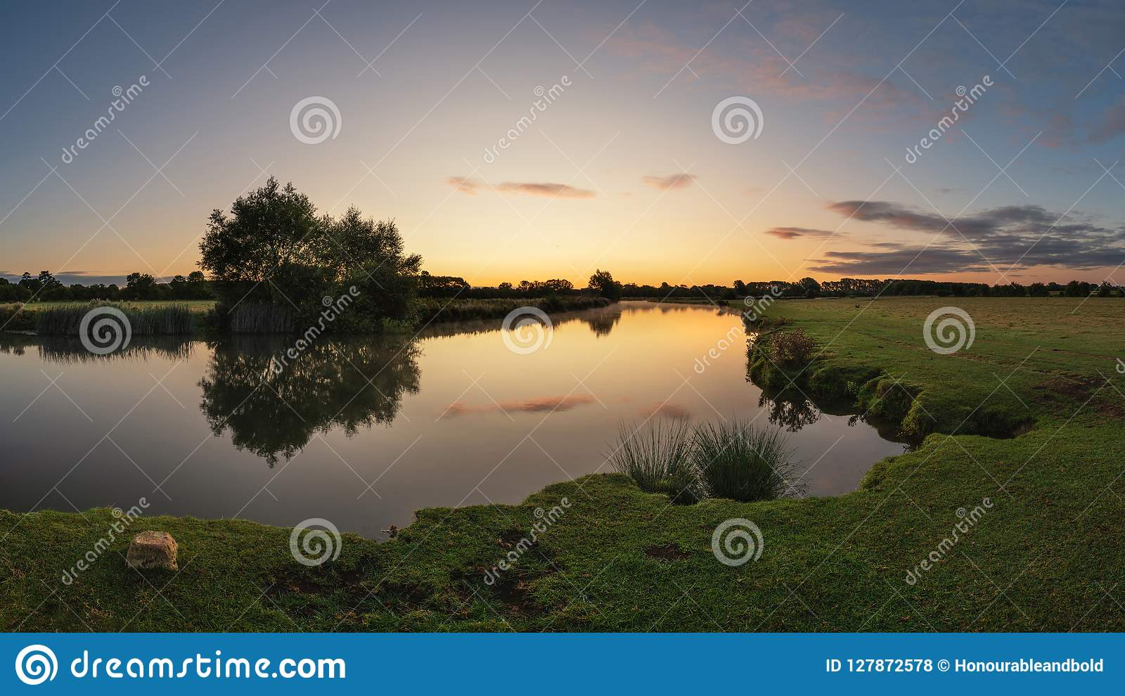 Beautiful dawn landscape image of River Thames at Lechlade-on-Thames