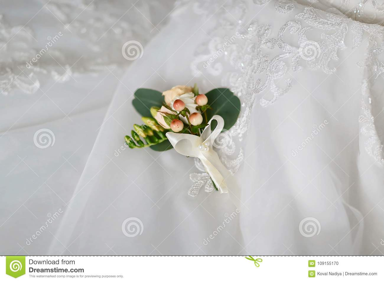 Beautiful Delicate Wedding Boutonniere With Creamy And White