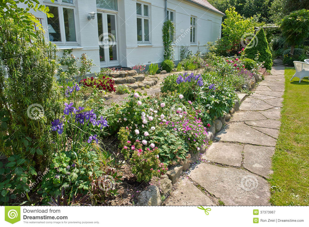 Beautiful delightful flower beds royalty free stock for Flower beds in front of house