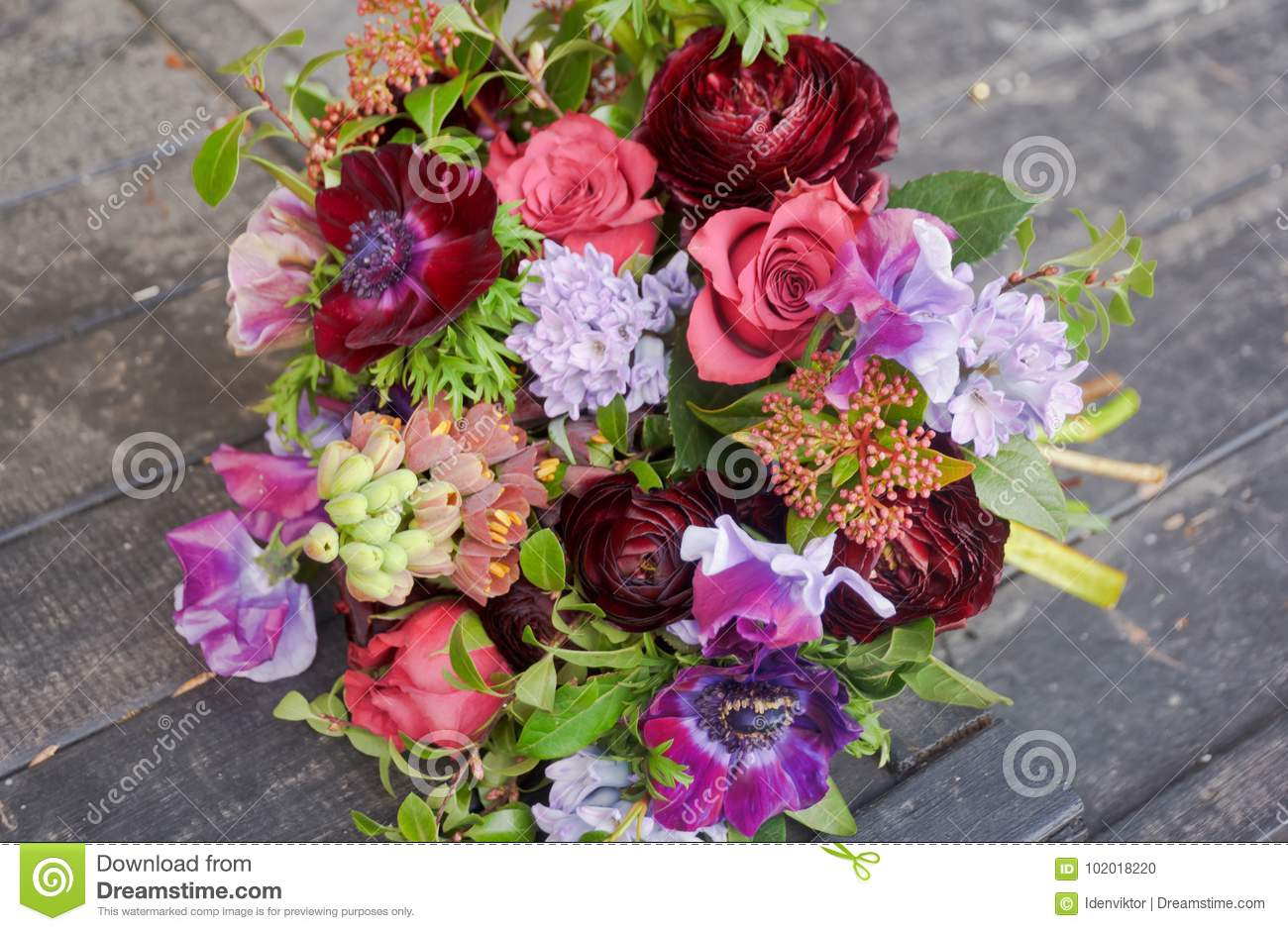 Beautiful designer red purple bouquet of florist with different download beautiful designer red purple bouquet of florist with different flowers stock photo image of izmirmasajfo