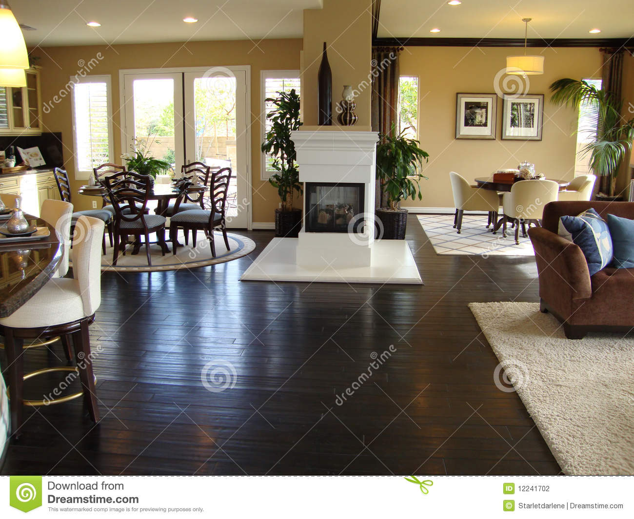 Beautiful Dining Room And Family Room With Wood Floors Area Rugs In