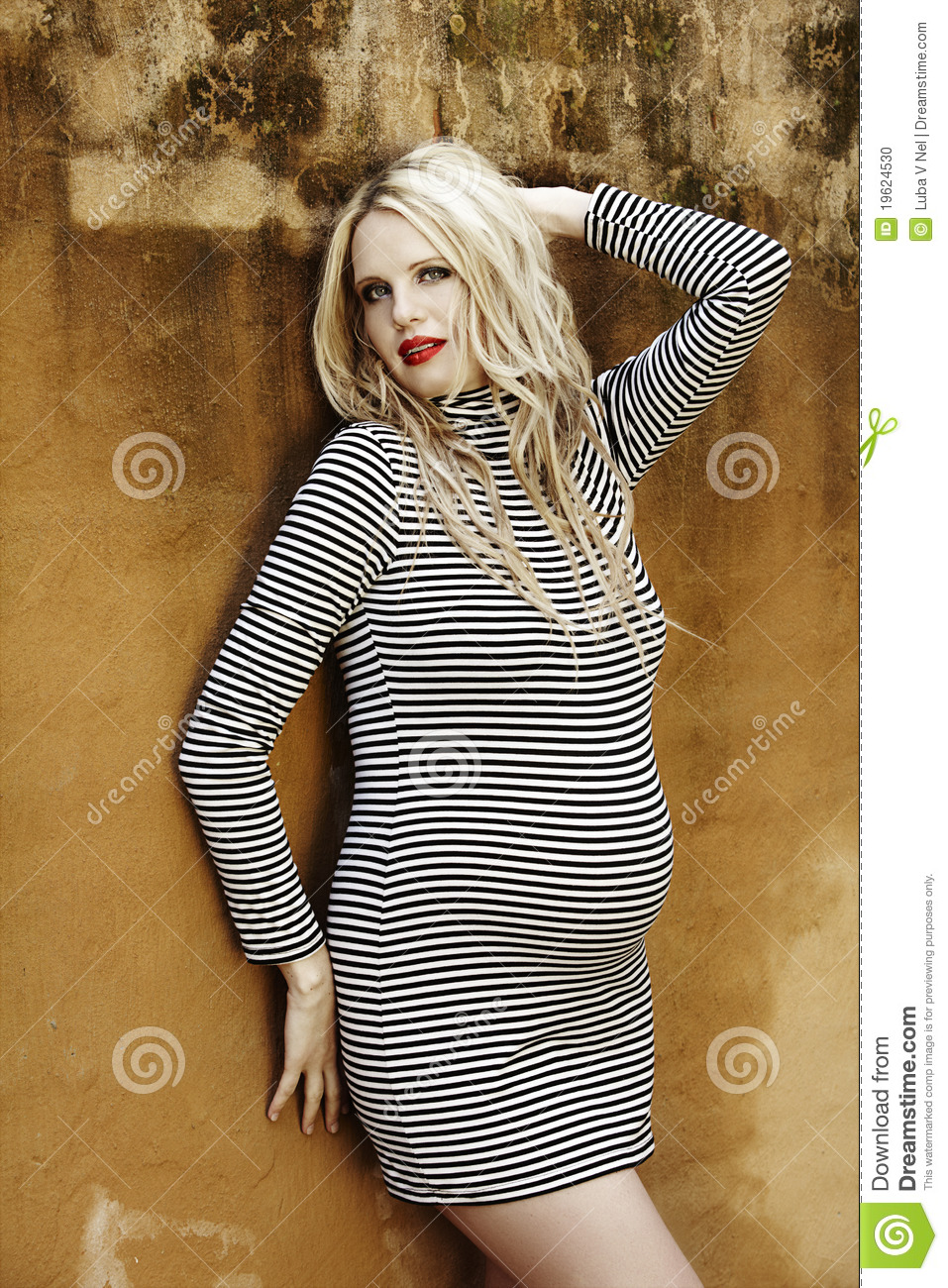 Beautiful eight months pregnant blond woman