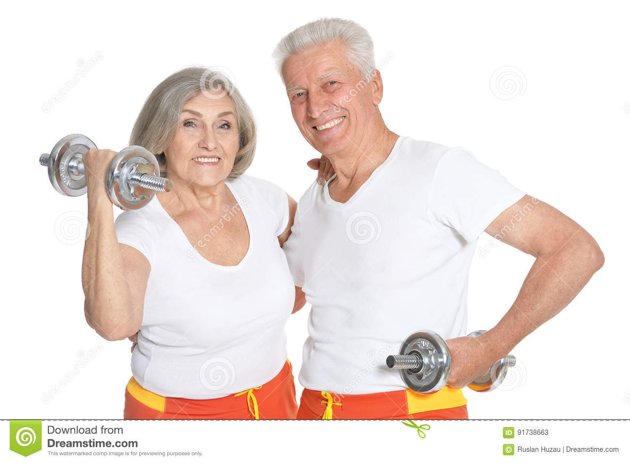 Beautiful elderly couple in a gym