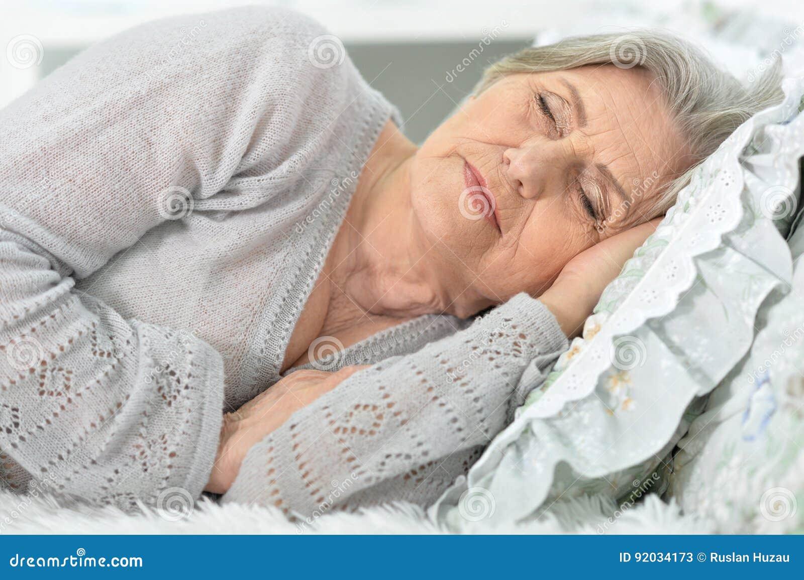 Beautiful elderly woman sleeping