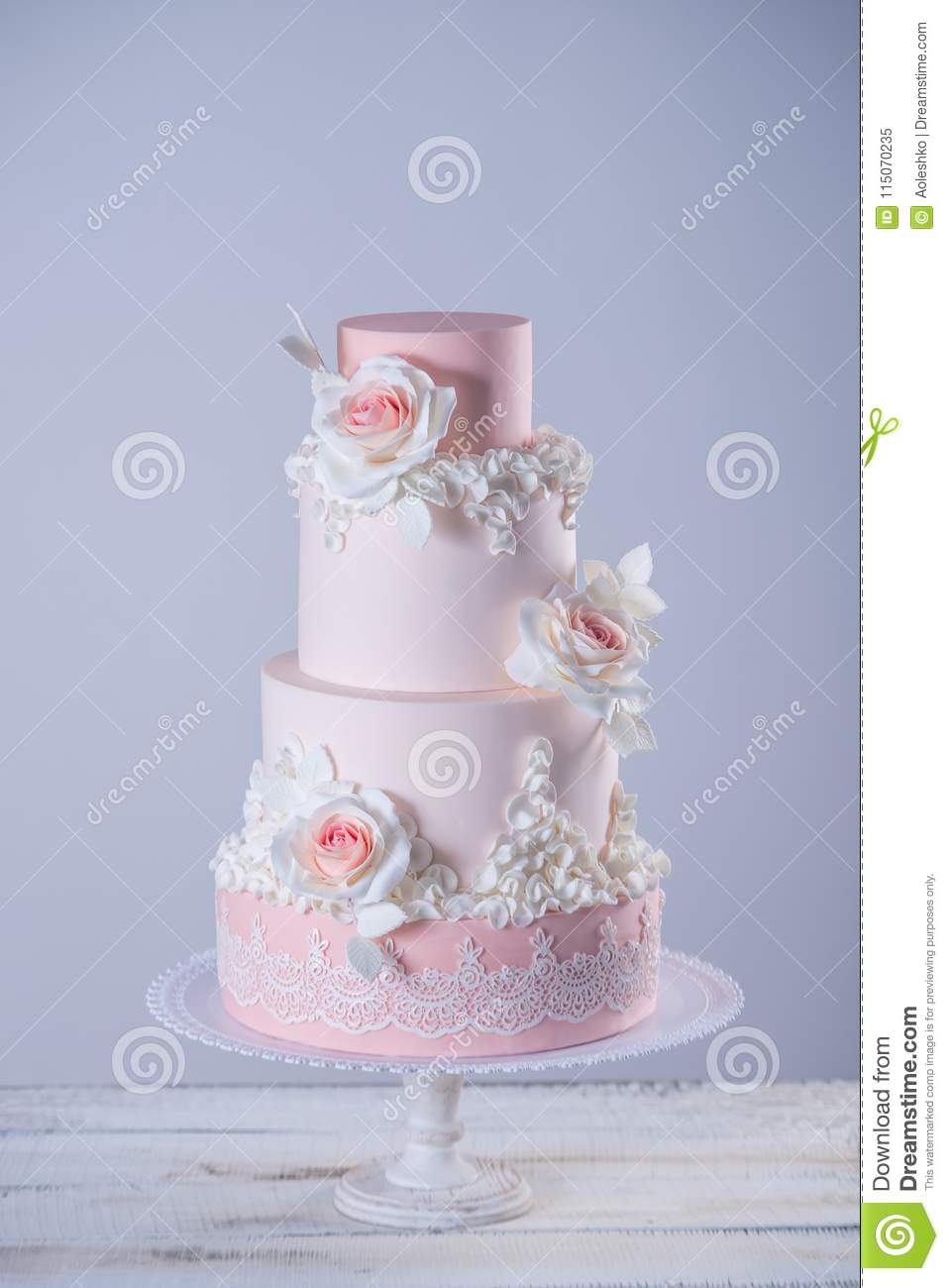 Beautiful Elegant Four Tiered Pink Wedding Cake Decorated With Roses