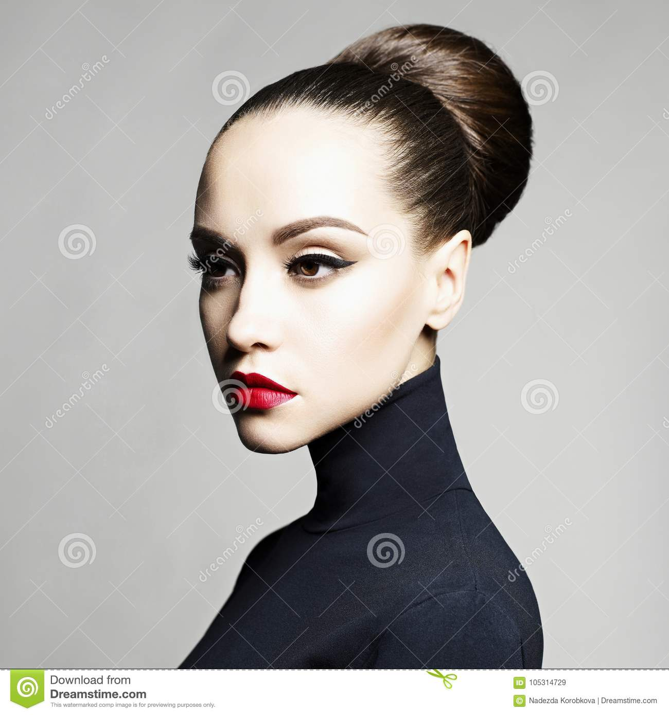 Beautiful elegant woman in black turtleneck