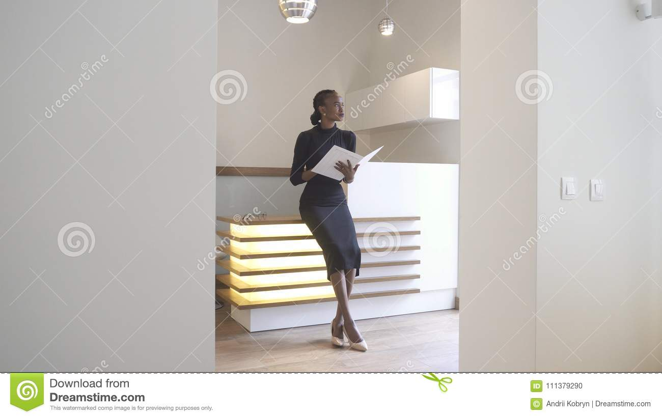 Download The Beautiful Elegent African Girl With Natural Make-up Is Working At The Reception. She Is Holding The Account Book Stock Photo - Image of elegant, checkin: 111379290