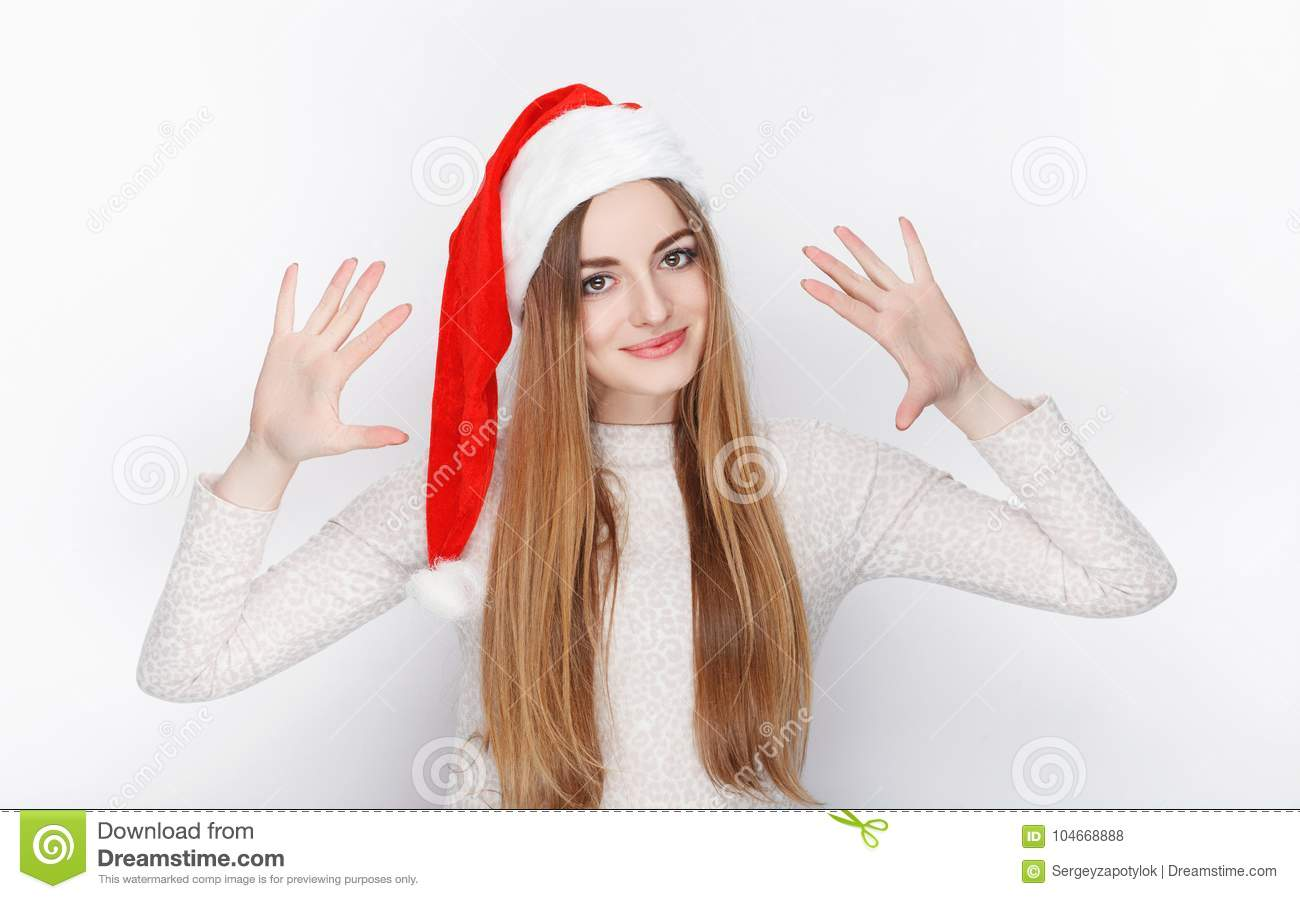 beautiful emotional blonde female lady wear santa claus hat christmas and happy new year greetings concept