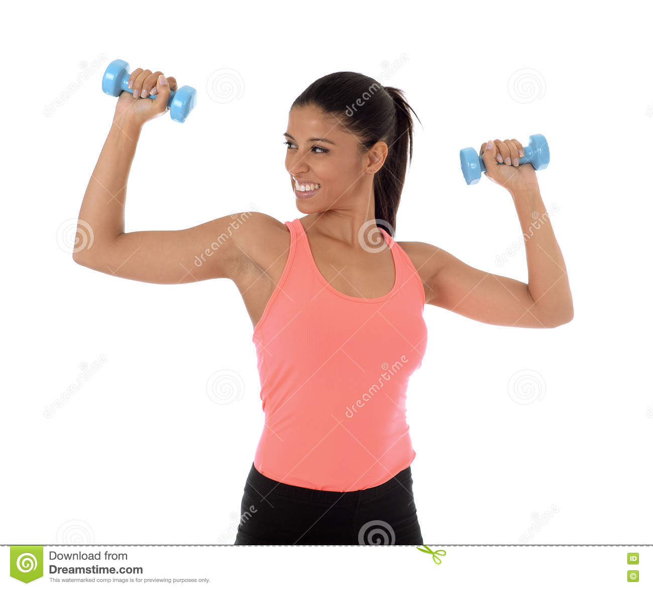 Beautiful and exotic hispanic woman holding hand weights training in fitness concept