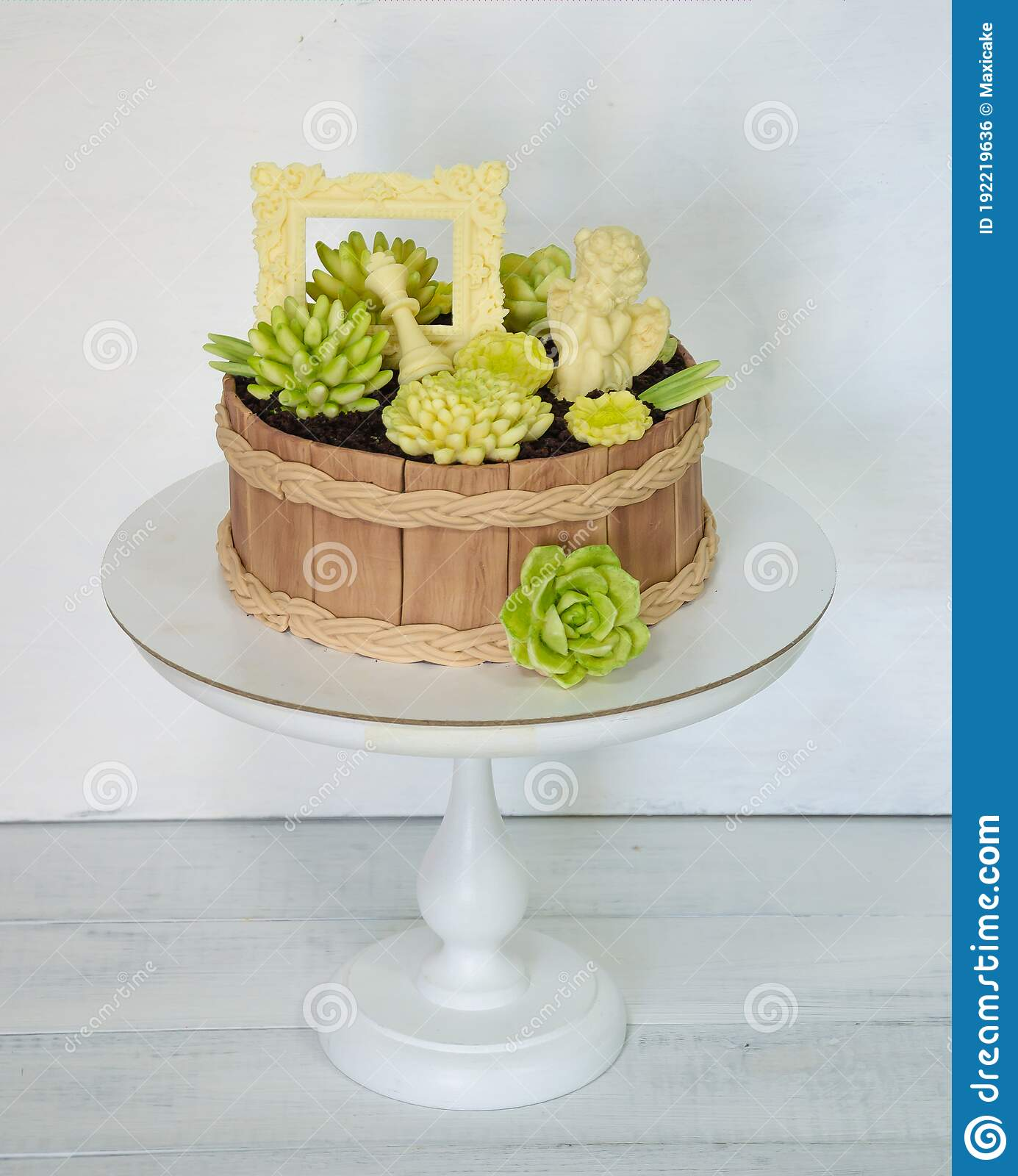 Beautiful Extra Chocolate Cake With Succulents And An Angel Stock Photo Image Of Succulent Wedding 192219636