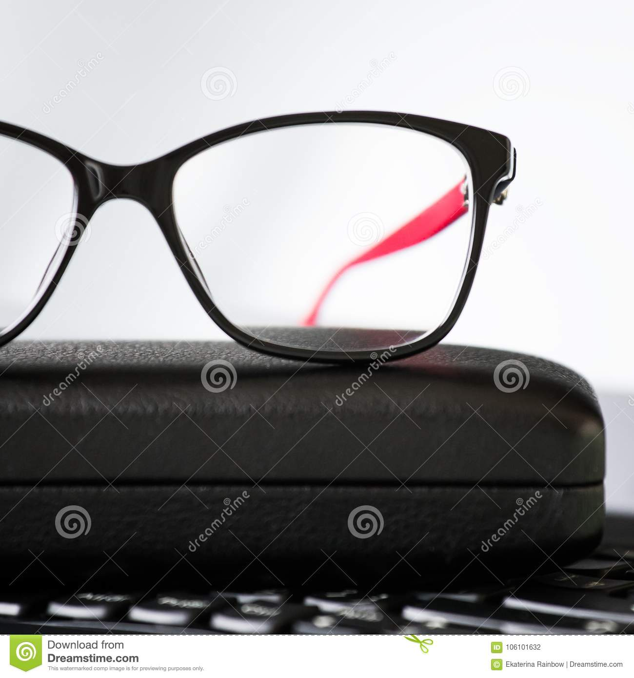 eb3623bba4 Beautiful eye glasses and laptop. Business optical background. Plastic lens  glasses and black red frame. Woman fashion style.