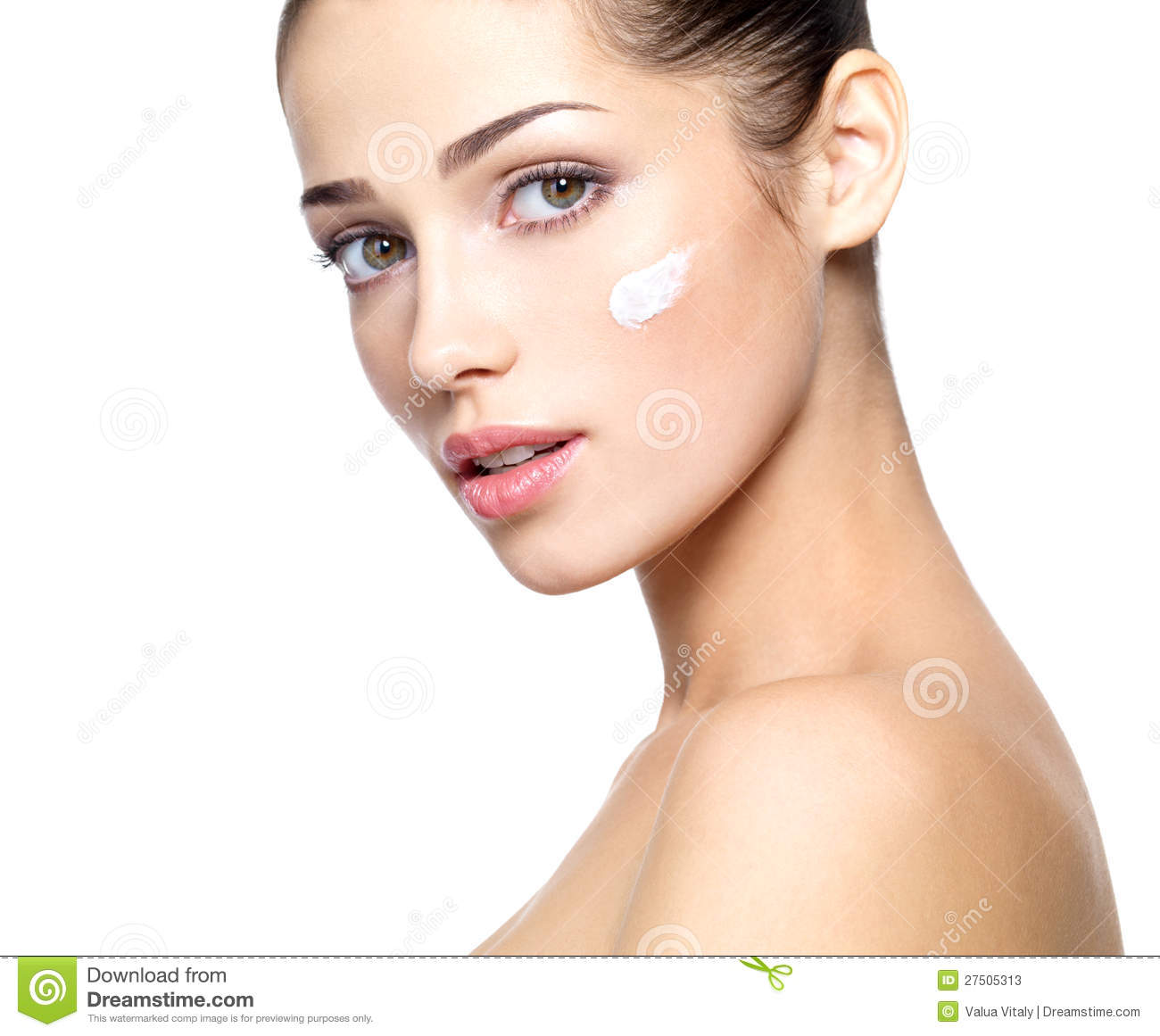Beautiful face of young woman with cosmetic cream on a cheek. . Skin ...