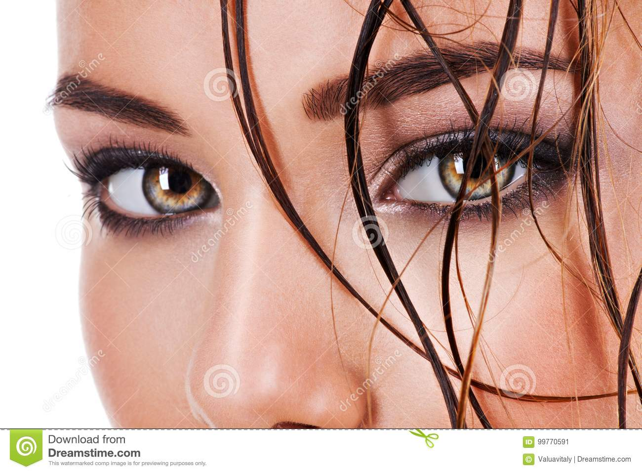 Beautiful Face Of A Woman With Dark Brown Eye Makeup Stock Image