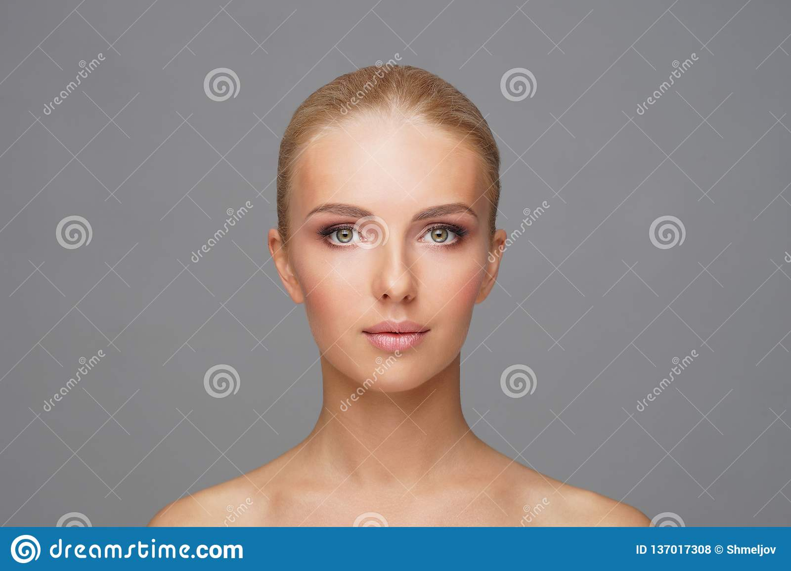Beautiful face of young and healthy girl. Skin care, cosmetics and face lifting concept.