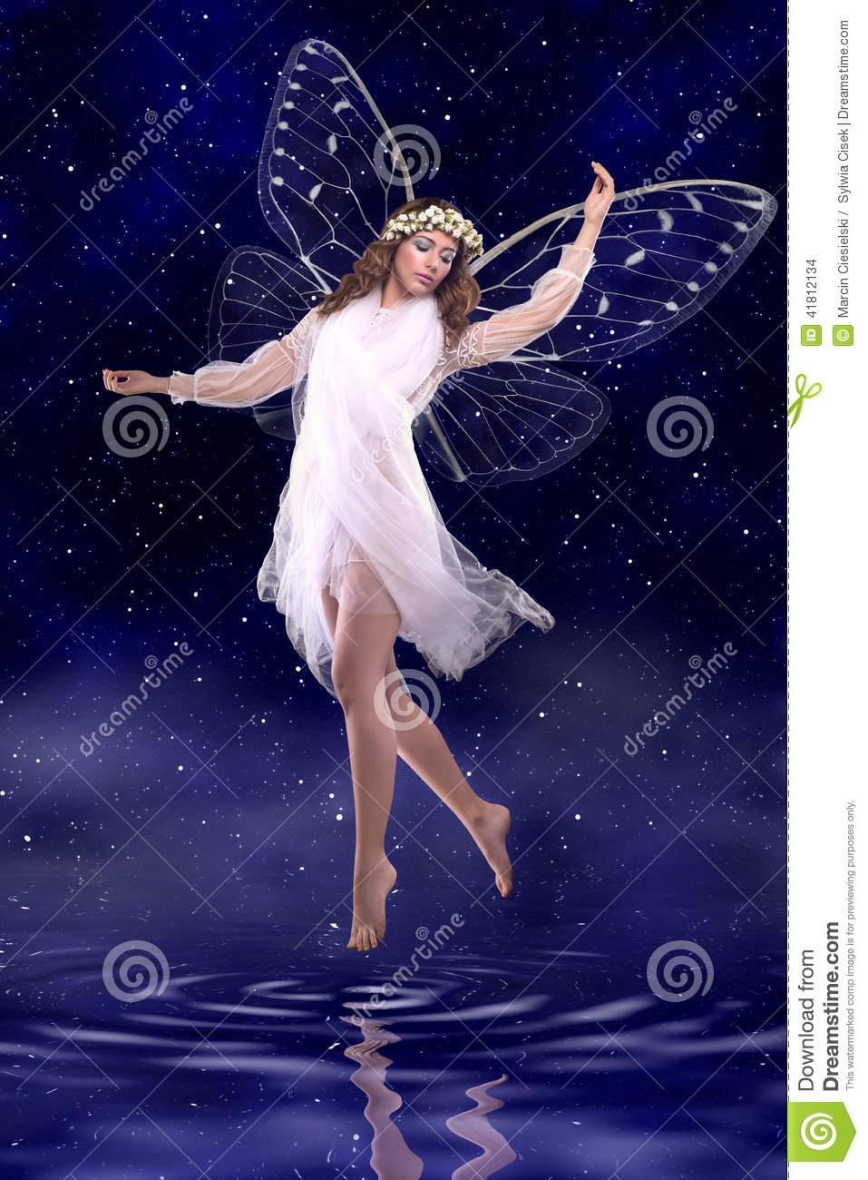 Beautiful Fairy Dancing Above Water on night fairy tale