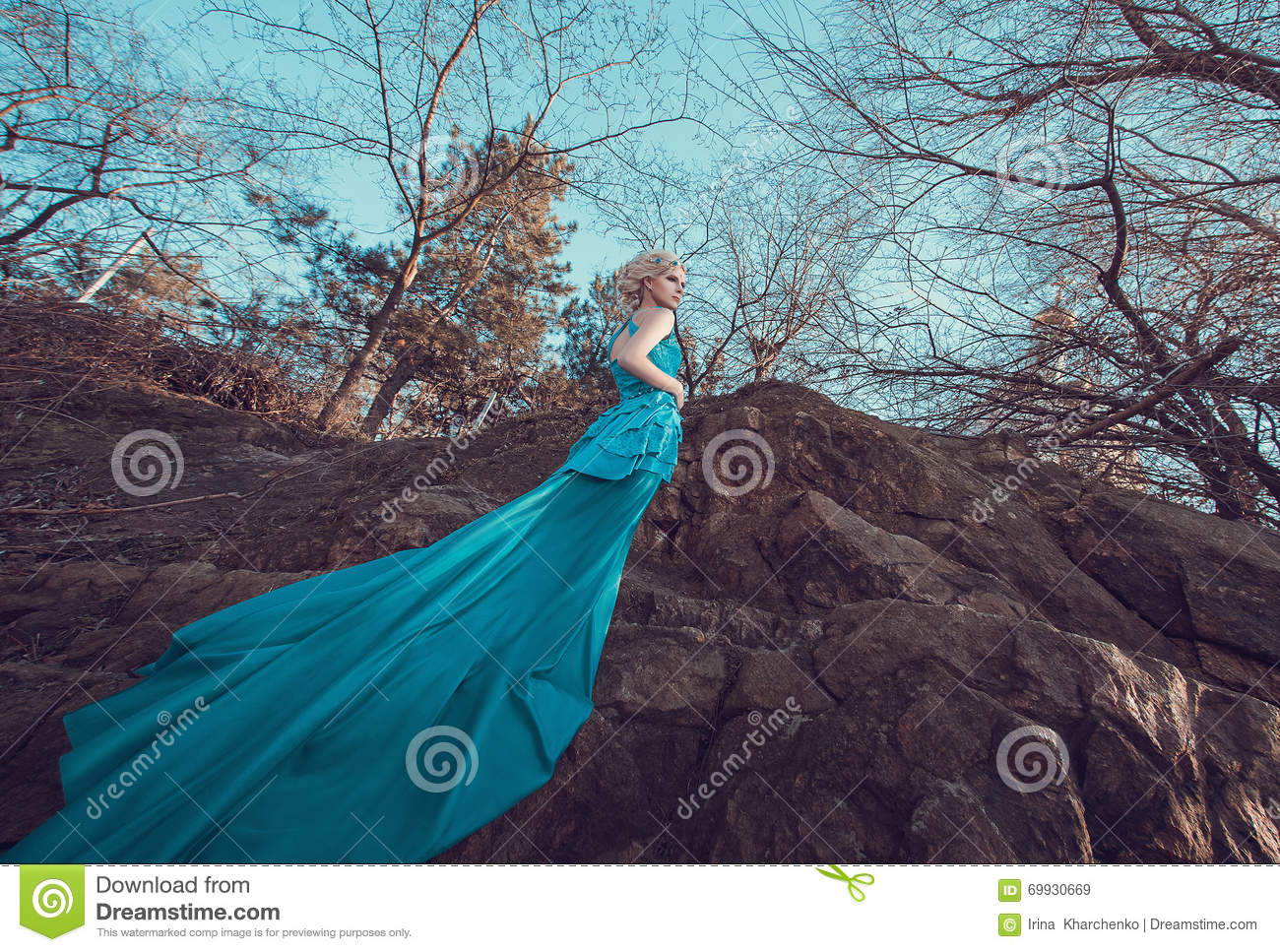 Beautiful fairy in a long turquoise dress