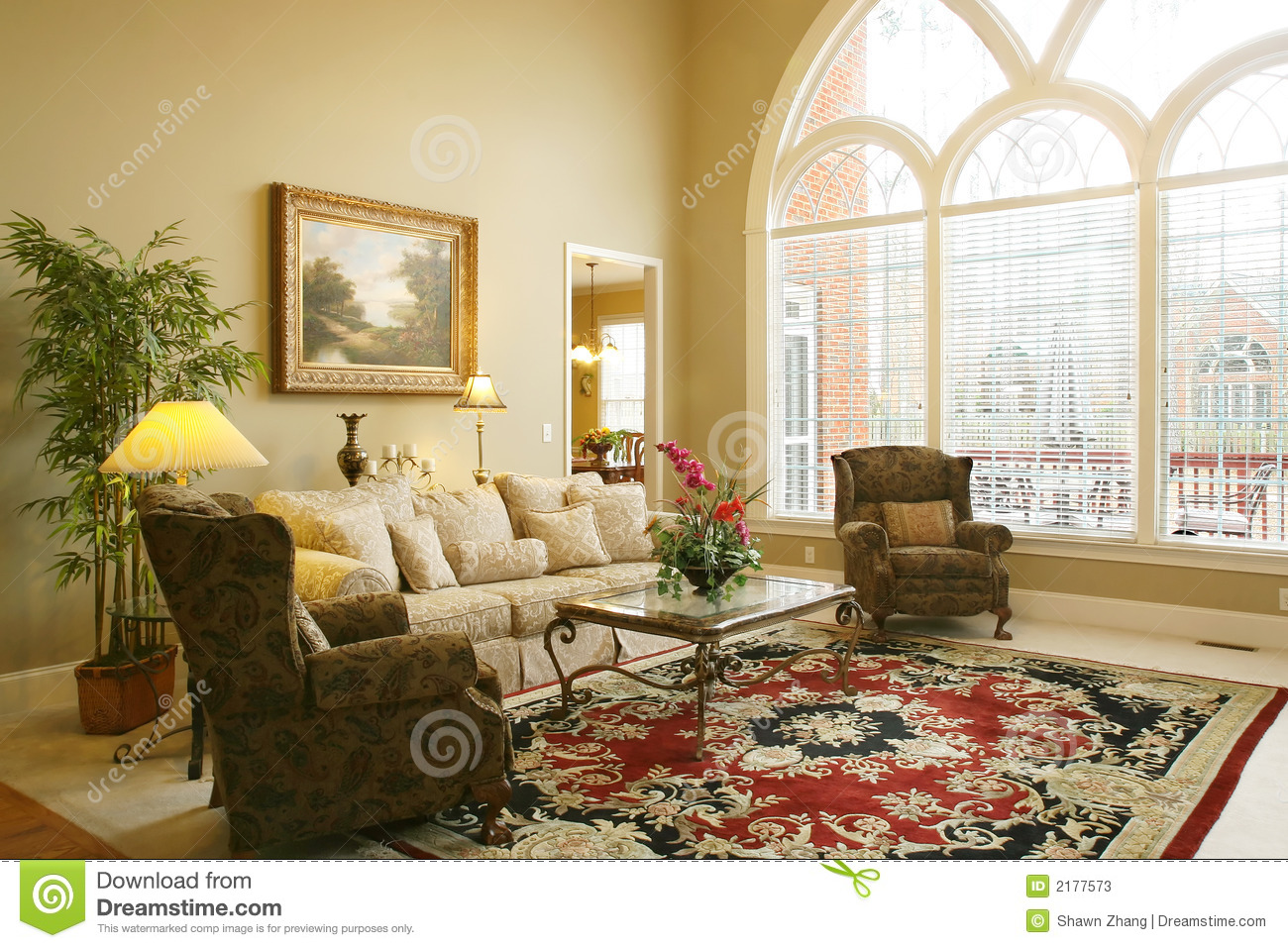 ... family room with arched windown and traditional style furniture