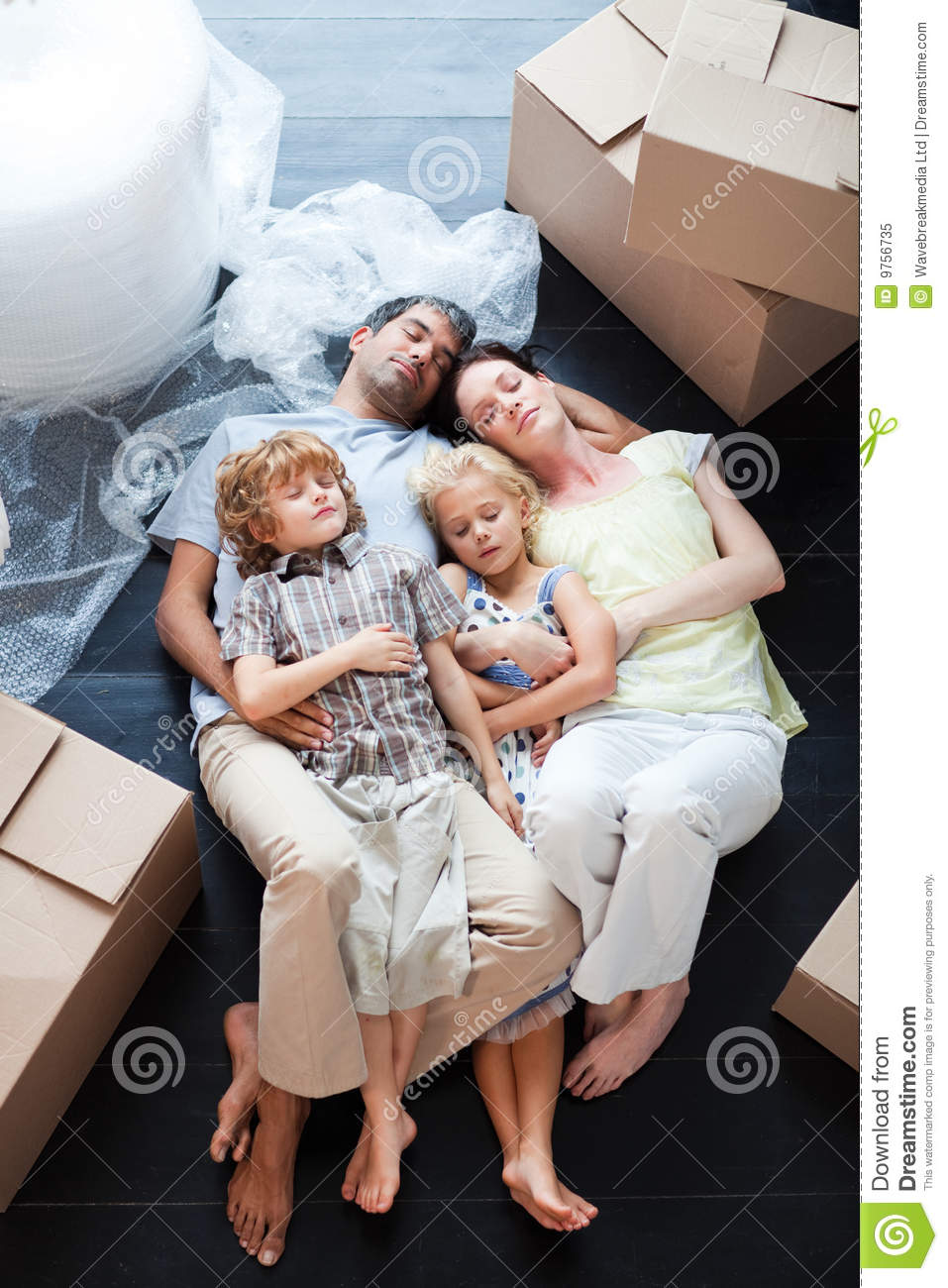 Beautiful Family Sleeping On The Floor Royalty Free Stock