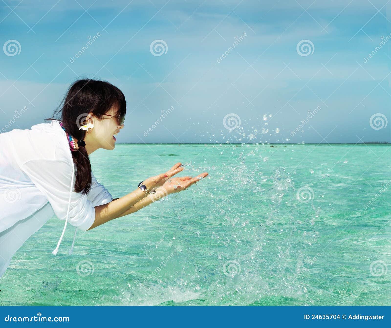 Beautiful Fashion Asian Girl Play Water In Summer Stock