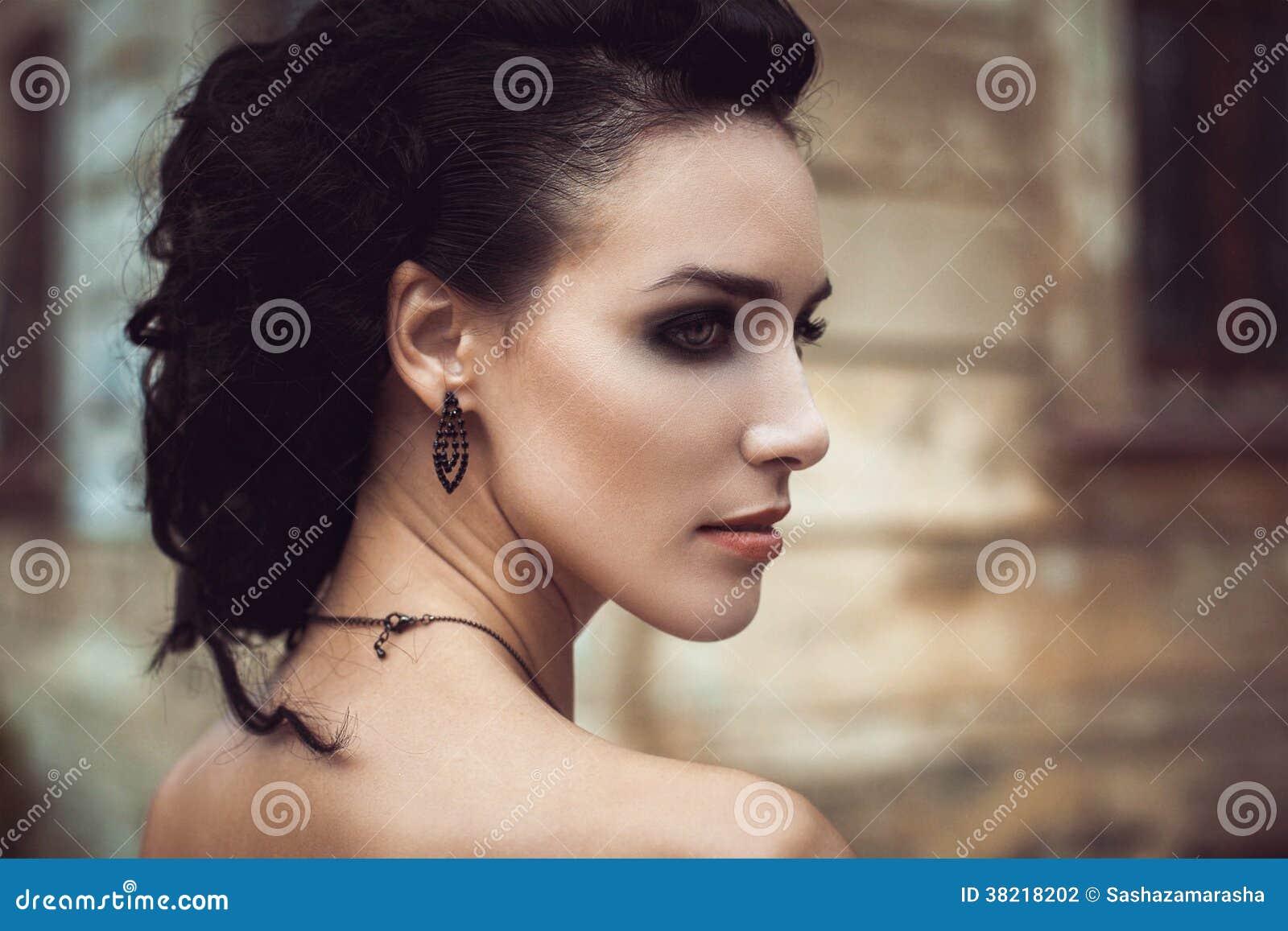 Beautiful fashion brunette woman creative hairstyle street portrait