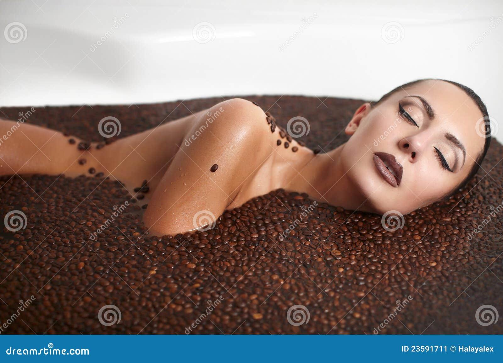 Beautiful fashion girl in jacuzzi with coffee
