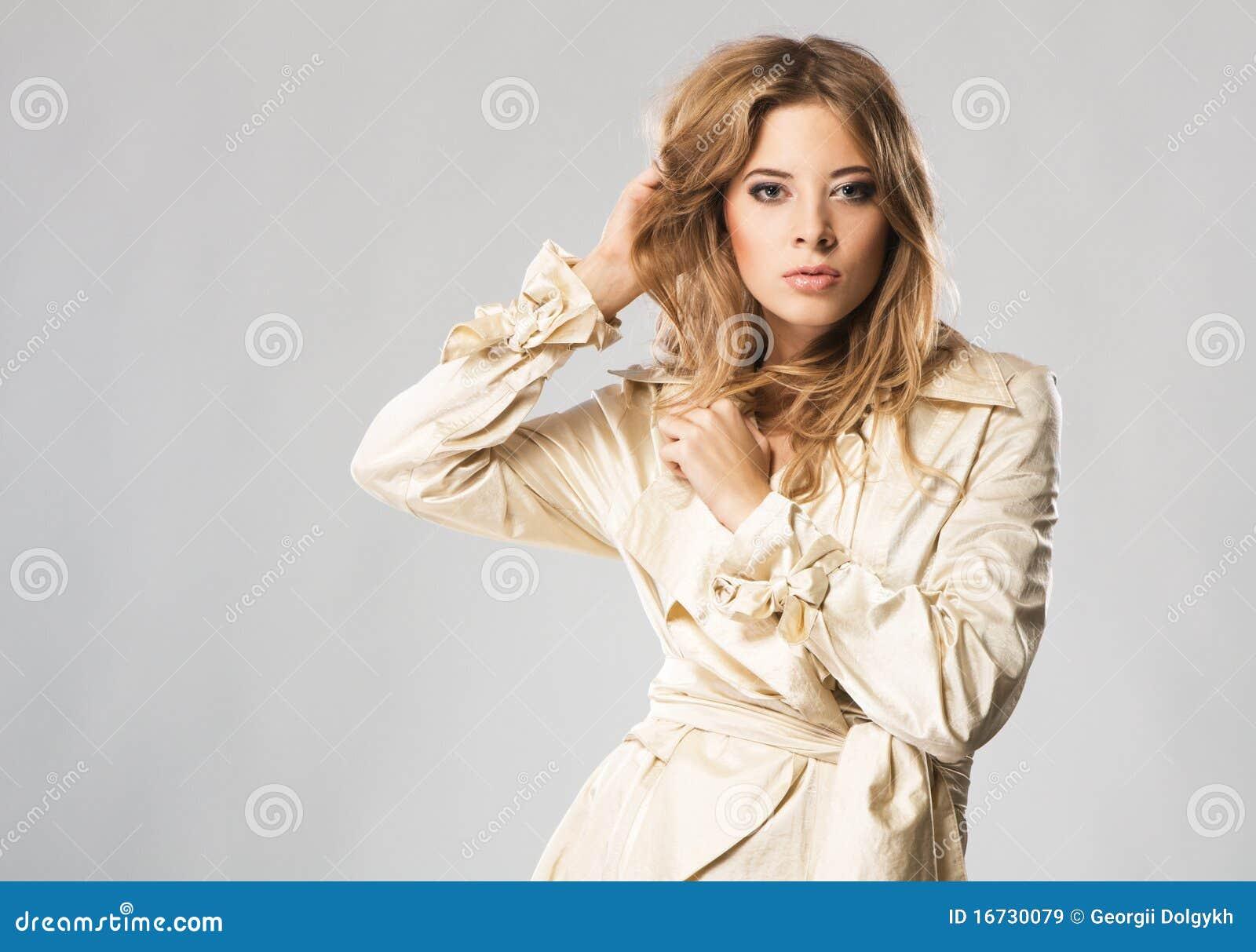 Beautiful fashion model in beige coat
