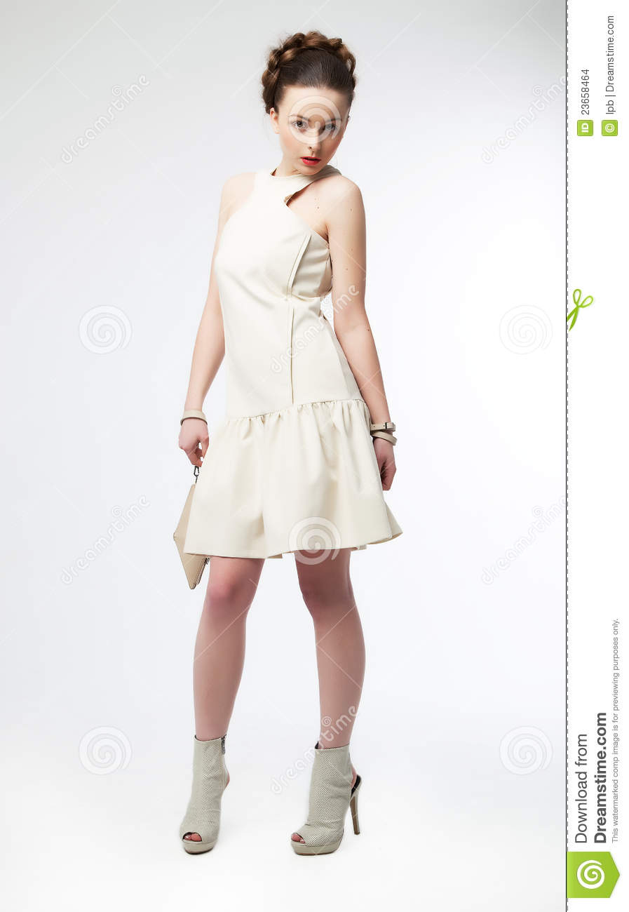 Beautiful Fashion Model Girl In White Dress Posing Stock