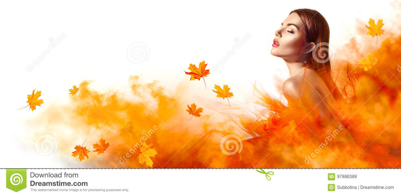 Beautiful fashion woman in autumn yellow dress with falling leaves